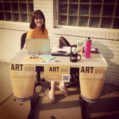 An intern at the Artshare table, courtesy Southern
