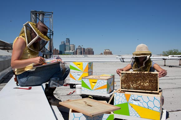 Judy Gerdts and Becky Masterman of the Bee Squad atop the Minneapolis Institute of Arts