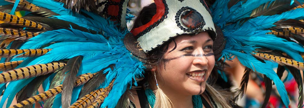 Aztec Ketzal Coatlicue dancer at the May Day Parade - Bill Kelley