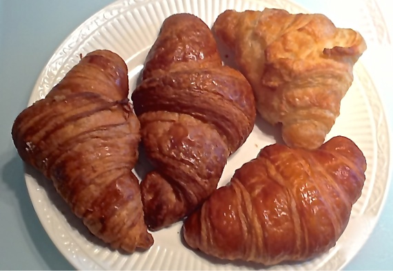 Croissants from (clockwise from left) Patisserie 46, Rustica, Trung Nam, and Chez Arnaud